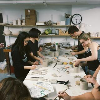 ceramic studio students working